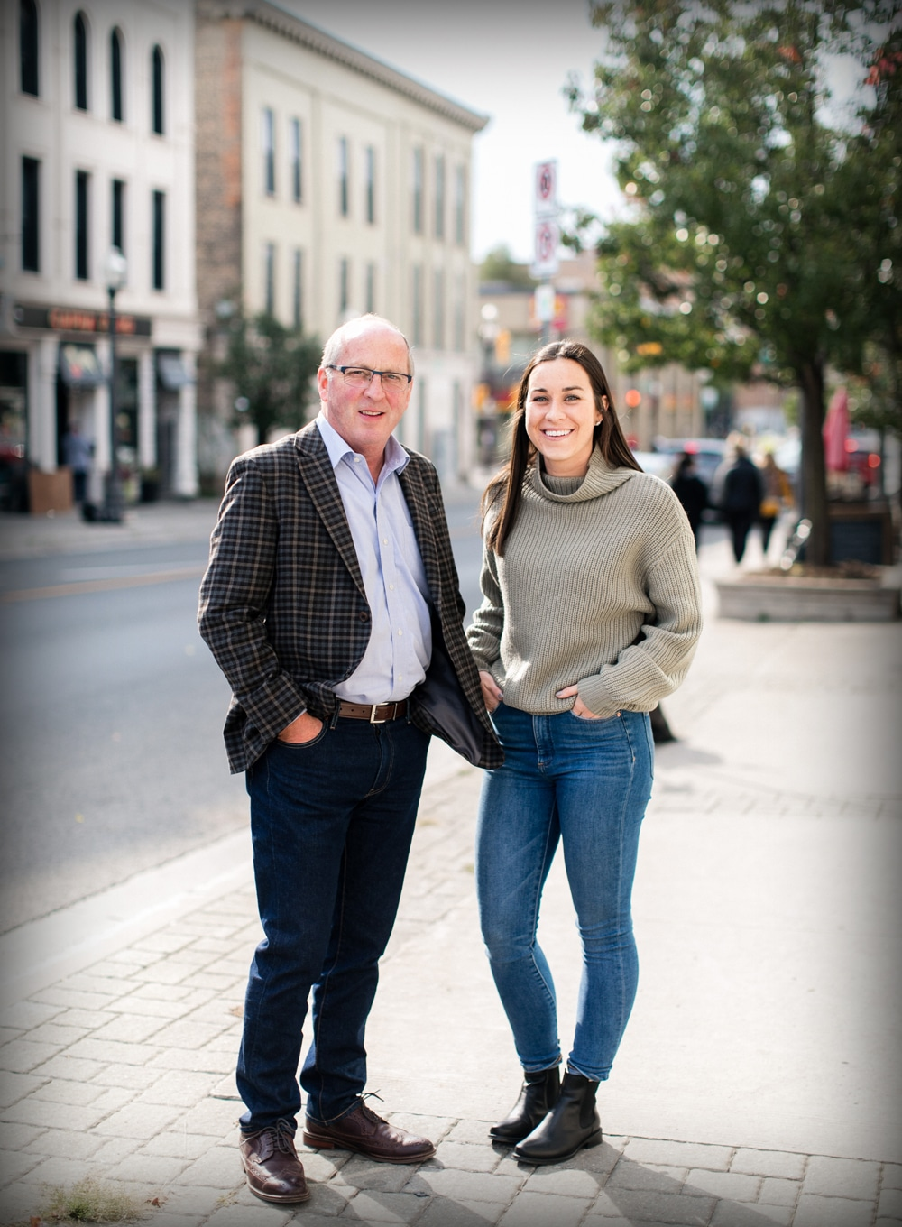 Ken and Laura Barrick standing with smiles in downtown Peterborough, Ontario on Hunter Street East.