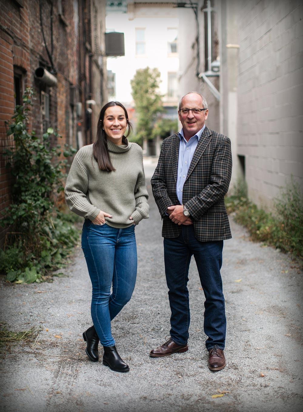 Ken and Laura Barrick standing with smiles in urban setting in downtown Peterborough, Ontario.